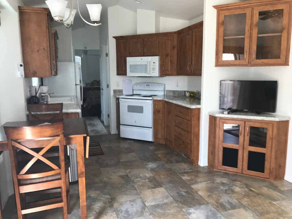 brown park model dining area and kitchen at cedar cove rv park