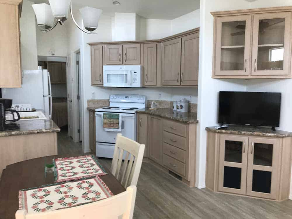tan park model dining area and kitchen at cedar cove rv park